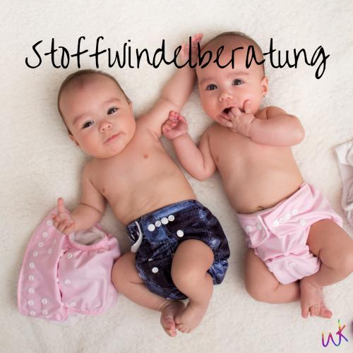 """Zwei Babys in Stoffwindeln liegen nebeneinander. Auf dem Bild steht """"Stoffwindelberatung"""". Stoffwindelberatung in Oldenburg"""